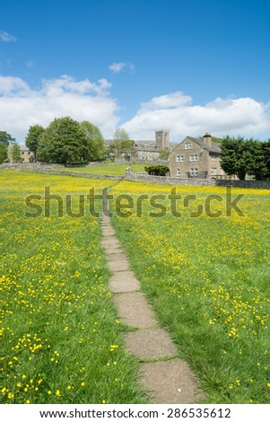 Askrigg village through the meadows in the Yorkshire Dales - stock photo