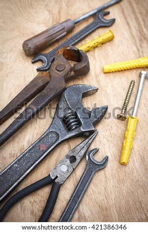 asorted tool on a wooden table - stock photo