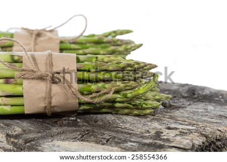 Asparagus fresh green asparagus into two bundles - stock photo