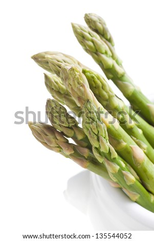 Asparagus in the cup on white background - stock photo
