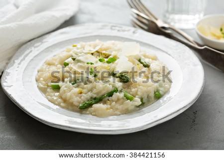 Asparagus lemon risotto with parmesan and lemon zest - stock photo