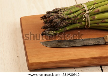 Asparagus on a unique cutting board - stock photo
