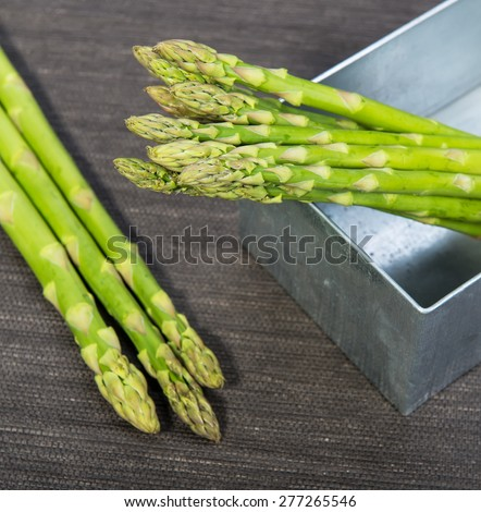 Asparagus on the black background - stock photo