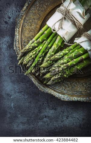 Asparagus. Raw asparagus. Fresh Asparagus.Green Asparagus. Tied asparagus in other positions. - stock photo