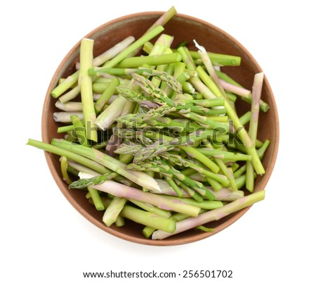 asparagus sliced in bowl on white background  - stock photo