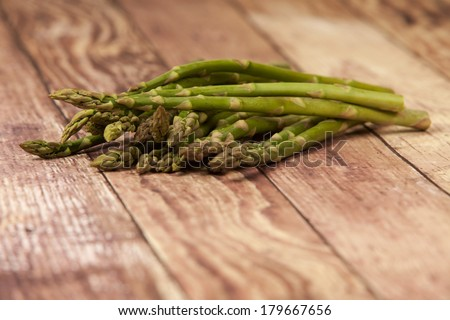 Asparagus Spears on A Rustic Background - stock photo