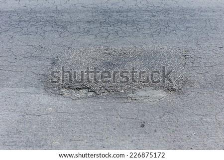 asphalt black road empty with repair damaged road - stock photo