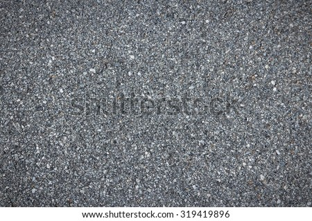 Asphalt concrete roadway pavement surface. Grey background. - stock photo