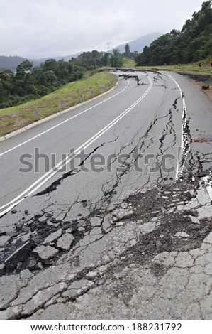 Asphalt Cracked Road Collapsed  - stock photo