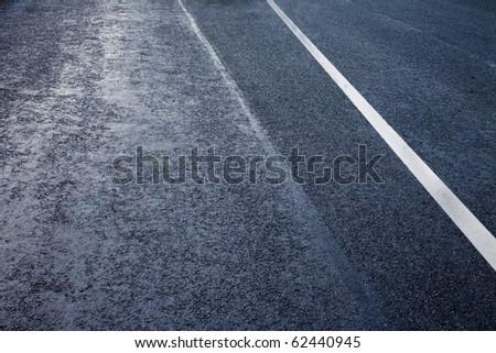 asphalt detail with white line - stock photo