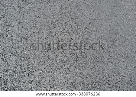 Asphalt from a carpark. This is completely newly laid and not yet driven on. - stock photo