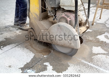 Asphalt or concrete cutting with diamond saw blade - stock photo