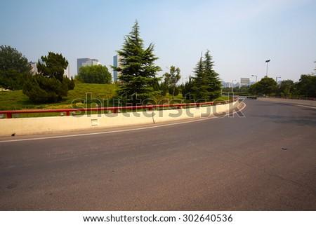 Asphalt pavement curve urban road - stock photo