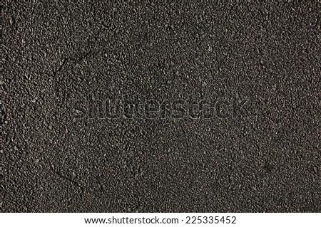 Asphalt Pavement Surface. Rough Road Texture Background - stock photo
