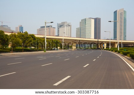 Asphalt pavement urban road - stock photo