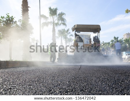asphalt pavement works for road repairing - stock photo