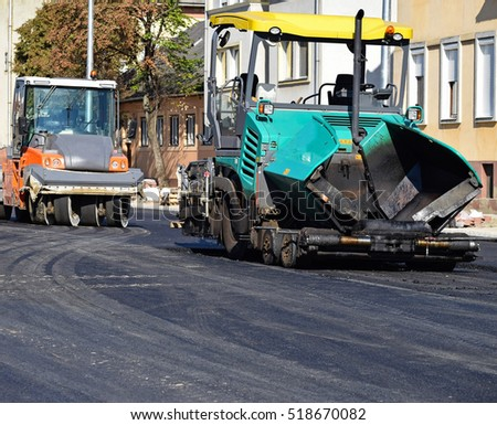 Asphalt paving vehicle and road roller at the road construction