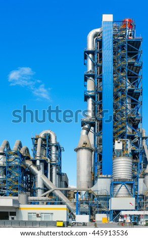 Asphalt Plant. Part of the construction of the asphalt plant close up on a background of blue sky
