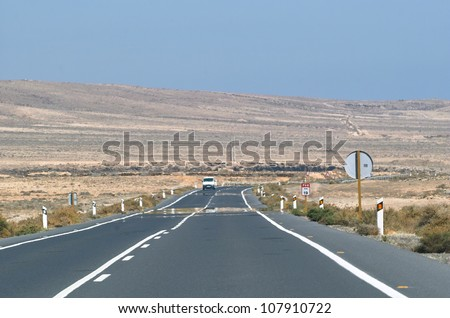 Asphalt road among the desert and hills. - stock photo