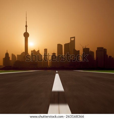 Asphalt road and modern city - stock photo
