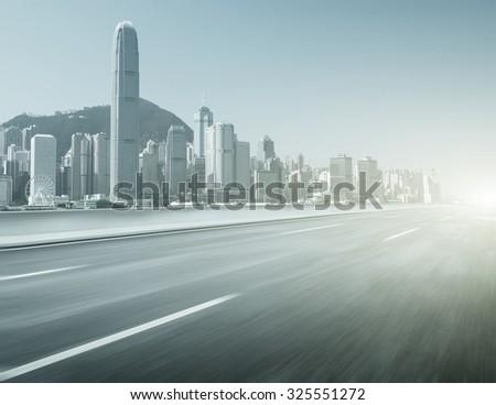 Asphalt road and modern city,Hong Kong - stock photo