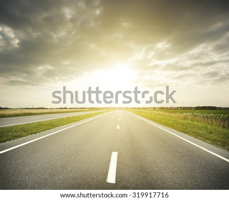 Asphalt road at evening - stock photo