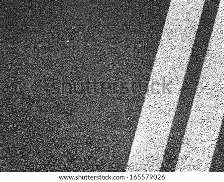 Asphalt road background. Double lines closeup - stock photo