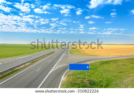 Asphalt road. Blank road sign - right turn. - stock photo