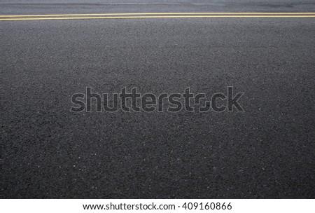 Asphalt road, detail of fresh new traffic road. - stock photo