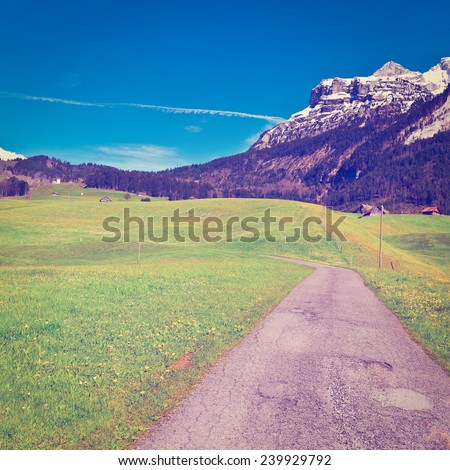 Asphalt Road High Up in the Swiss Alps, Instagram Effect - stock photo