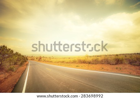 Asphalt road in rural with retro color - stock photo