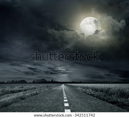 asphalt road night bright illuminated large moon - stock photo