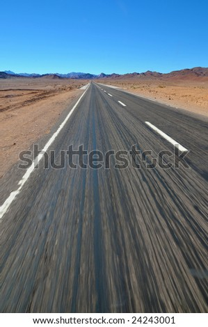 Asphalt road over desert nature - stock photo