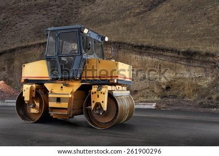 Asphalt road roller - stock photo