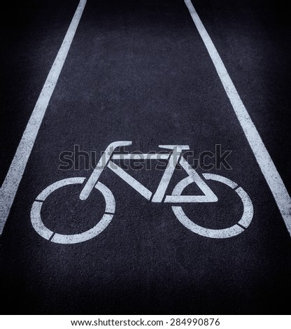 Asphalt road texture with two line and bicycle sign - stock photo
