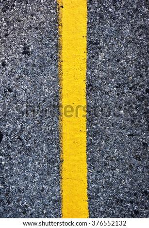 Asphalt road. texture with yellow stripe - stock photo