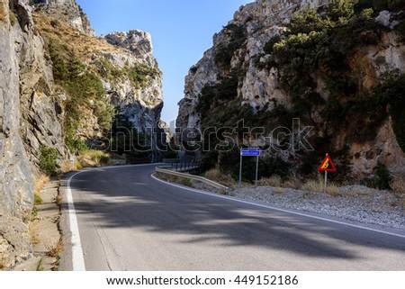 Asphalt road through Kotsifouu canyon on Crete island, Greece - stock photo