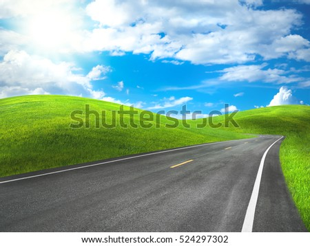 asphalt road through the green hill with beautiful sky