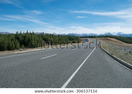 Asphalt Road to Aoraki Mount Cook with mountain range backdrop, South Island, New Zealand