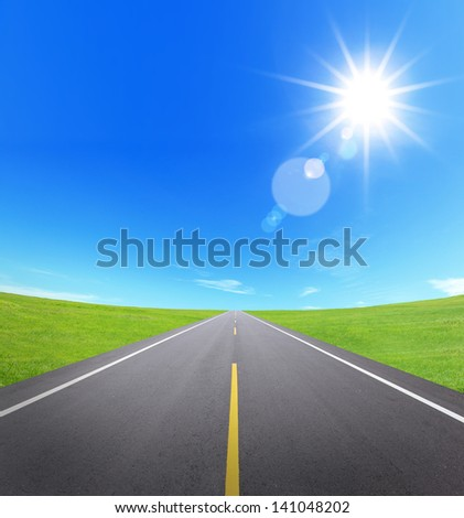 asphalt road with cloudy sky and sunlight, great for your design - stock photo