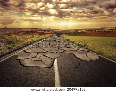 Asphalt road with cracks. Concept of problem and solution. - stock photo