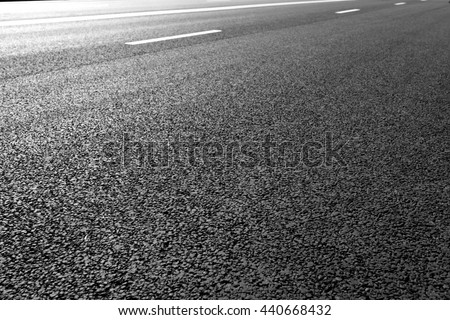 Asphalt road with marking lines white stripes