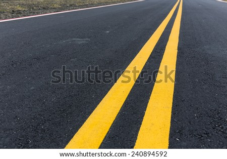Asphalt road with pair of yellow line