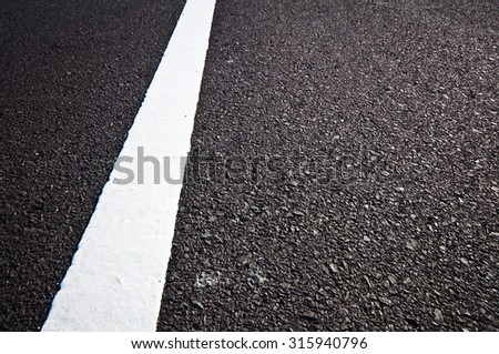 Asphalt road with separation white lines - stock photo