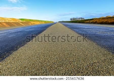 Asphalt road with white beautifful lines - stock photo