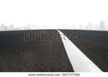 Asphalt road with white line and urban scene - stock photo