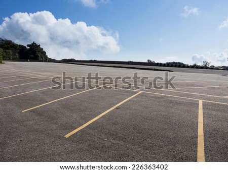 asphalt roadway parking lot with cloud blue sky background - stock photo