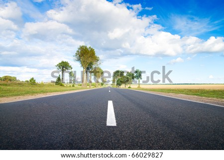 Asphalt rural road to green hills.  Belarus