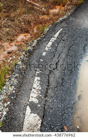 Asphalt surface, the curve of the road were demolished due to poor construction.