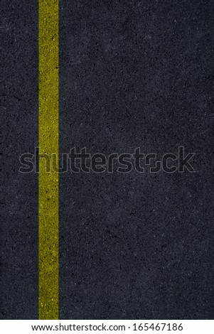 Asphalt texture with yellow line. Rough asphalt background.